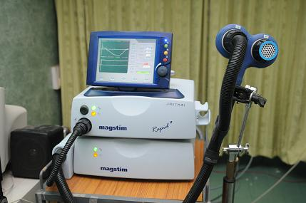 The Transcranial Magnetic Stimulator (TMS).
